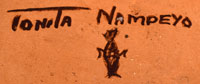 """The bottom of the jar is signed """"Tonita Nampeyo"""" and marked with her clan's corn symbol."""
