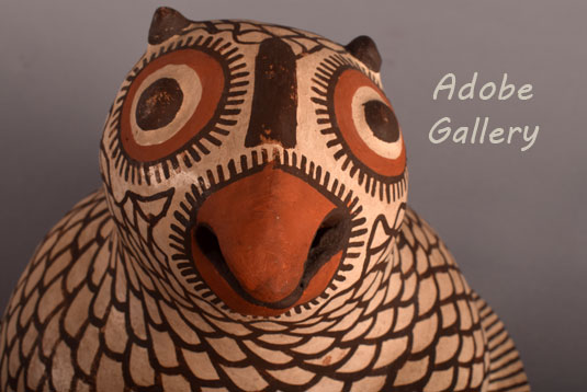 Close up view of the face of this owl figurine.