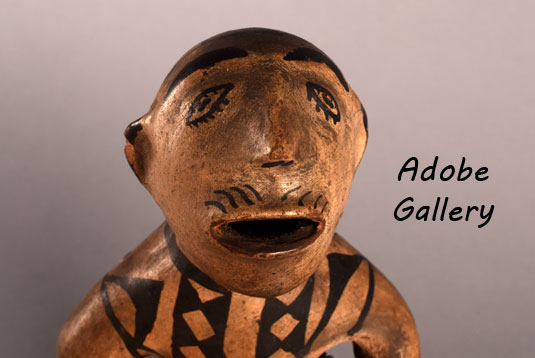 Close up view of the face of this figurine.