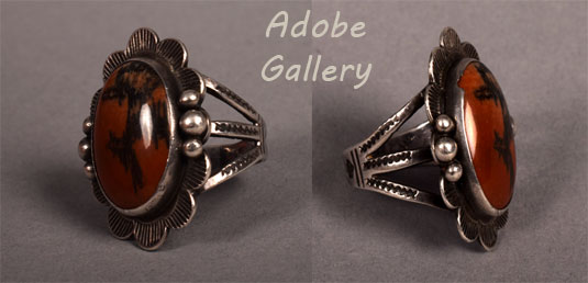 Alternate side views of the same ring.