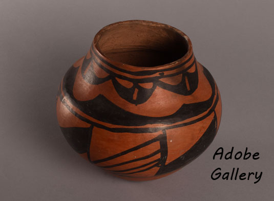 Alternate view off this beautiful pottery jar.