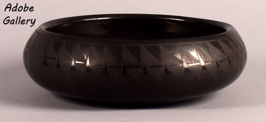 Alternate side view of this blackware bowl.