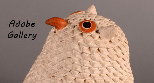 Alternate close up view of the face of the owl figurine.