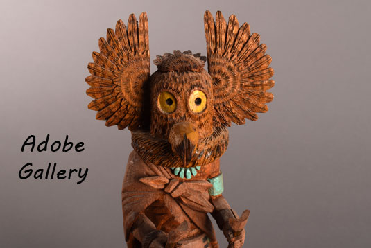 Close up view of the face of the owl Kachina Doll.