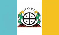 The flag of the Hopi Nation is used by the Native American Hopi people of Arizona in the United States who live on the Hopi Reservation. The flag is a vertical tricolor of turquoise, white, and yellow, with the Hopi symbol in the middle.  The flag is accompanied by a red fringe.