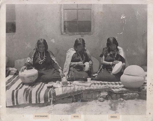 As Dr. Ed Wade has frequently stated, there were many Hopi-Tewa potters working at the same time as Nampeyo.  Evidence of this is illustrated in this rare photograph of three potters staged by an unknown photographer at an unknown date.  The potters are identified as Potchangwe, Nuva, and Gweka.  We are appreciative to Hopi-Tewa potter, Mark Tahbo, for sharing this photograph with us.  The photograph was recently found in a burned out home at First Mesa.
