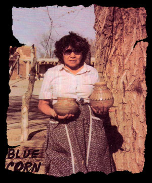 "Blue Corn was born in San Ildefonso around 1923 and was encouraged by her grandmother, at an early age, to ""forget school and become a potter."" She did attend school at the pueblo and later at the Santa Fe Indian School, however. At age 20, she married Santiago, a Santo Domingo Pueblo silversmith. During the 1940s, she worked at Los Alamos as a housecleaner for J. Robert Oppenheimer. Shortly after World War II, she took up pottery making and found her calling.  Blue Corn is famous for re-introducing San Ildefonso polychrome wares which had become a lost product after the blackware of Maria and Julian had become in such demand in the 1920s. She also made blackware and redware but is most often associated with polychrome wares.  Blue Corn passed away on May 3rd, 1999."
